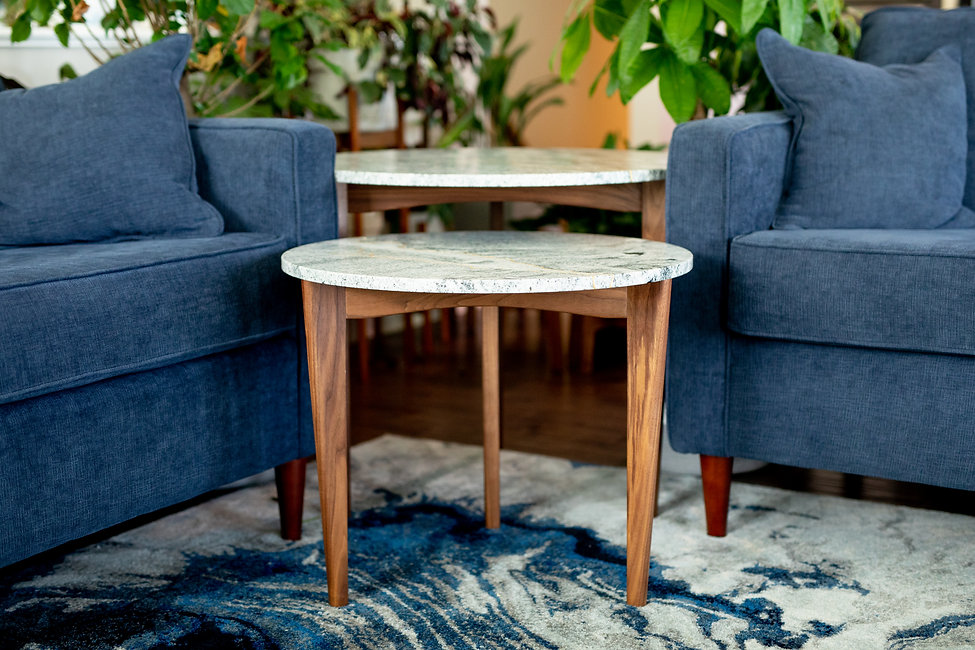 Granite and black walnut end tables with gold leaf inlay