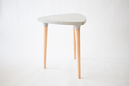 A balcony table that withstand the elements and the test of time due to its solid concrete top.