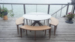 Oak outdoor table and benches with a solid granite top, to withstand vancouvers rainy environment