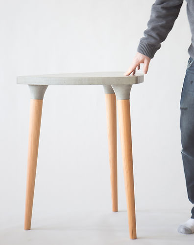 one of a kind concrete table that will be a great discussion piece