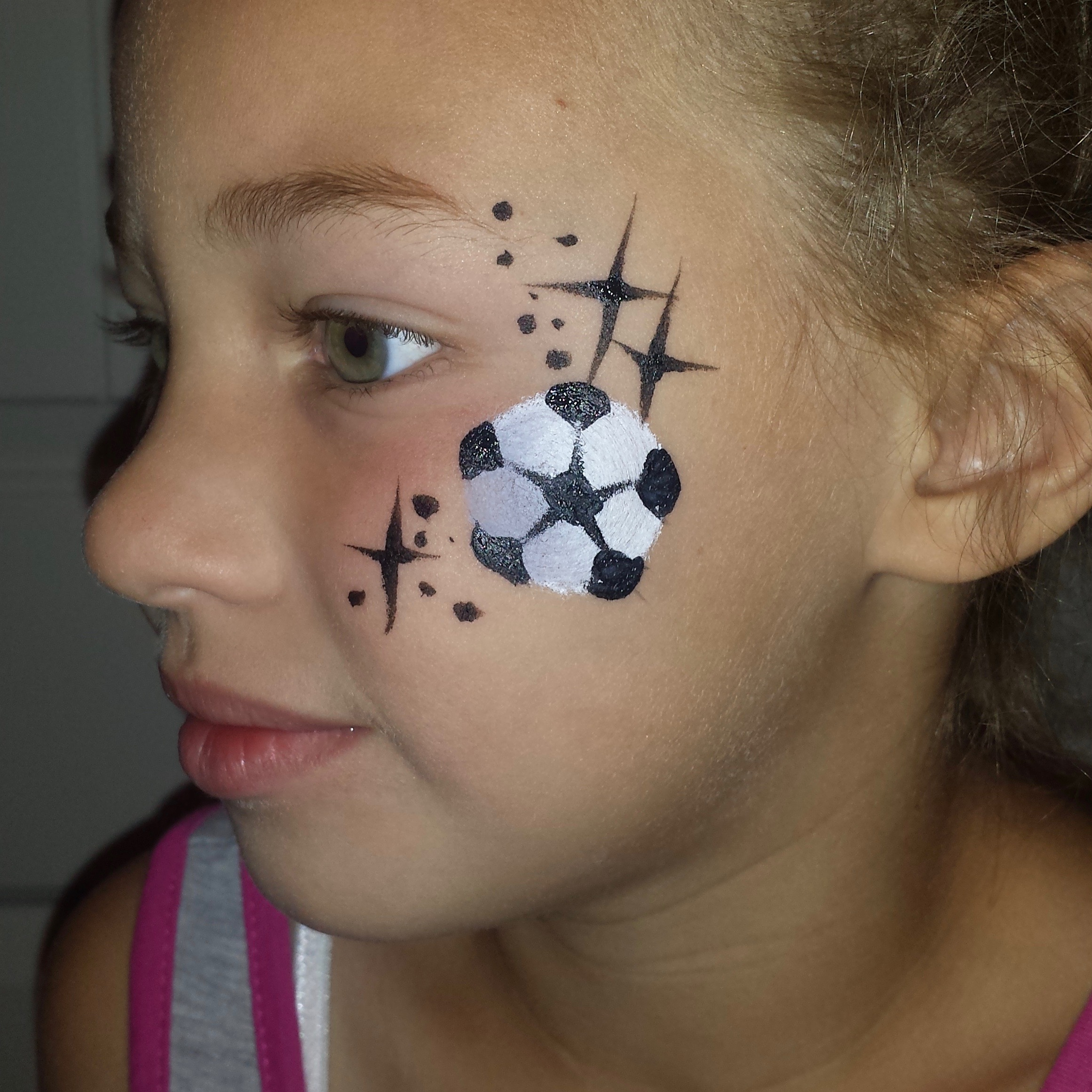 Soccer ball face paint