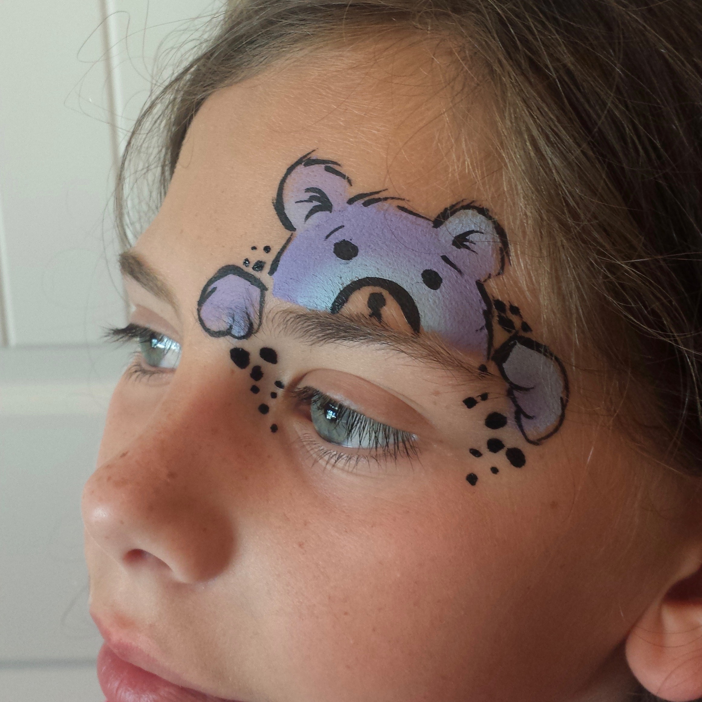 Peeking bear face paint