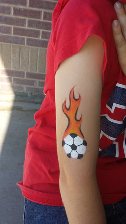 Flaming soccer ball arm paint