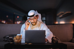 Arab man working from home sitting on so