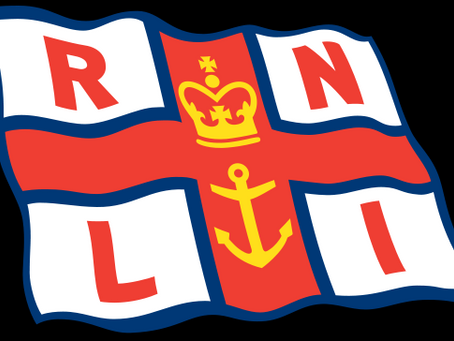 Four RNLI Cromer crew members pass important plans