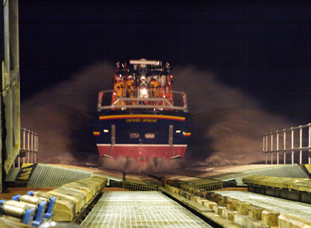 Three Norfolk RNLI stations join forces on overnight tow of stricken yacht.
