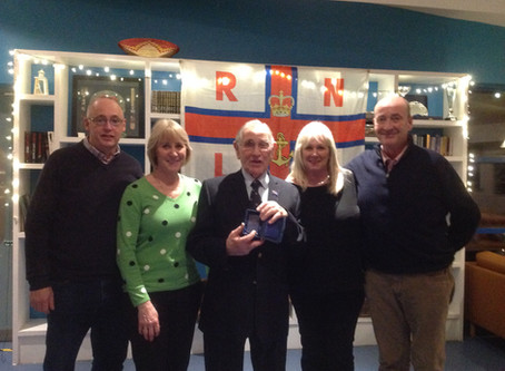 Cromer lifeboat volunteer receives award for over 60 years of service.