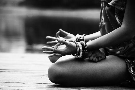 woman in a meditative yoga position sit