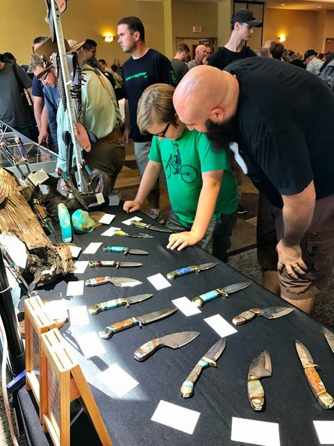Father and son admiring Feldman Custom Knives