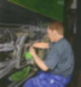 Painting of a man oiling a locomotive engine
