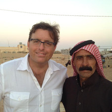Craig on the Syrian border with a new friend who fled the conflict with his family.