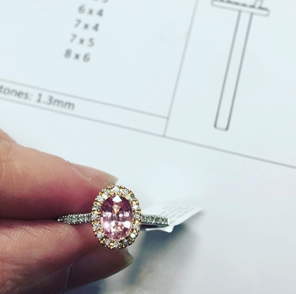 Bespoke, pink sapphire halo engagement ring made in the Jewellery Quarter