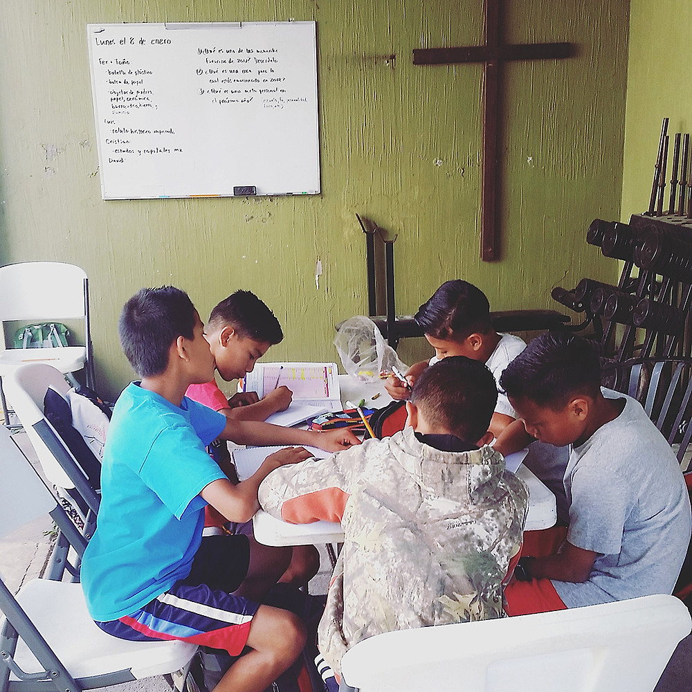 Boys studying at Hope House.