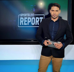 """Clive puts the """"LIVE"""" in Sports Report."""