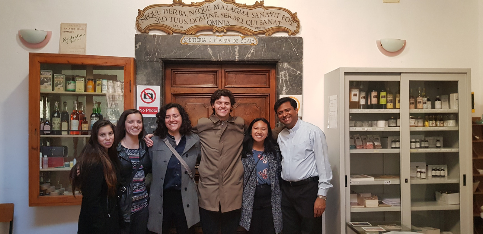 Fellows with Fr  Rudy Pinto at the oldest pharmacy in Europe