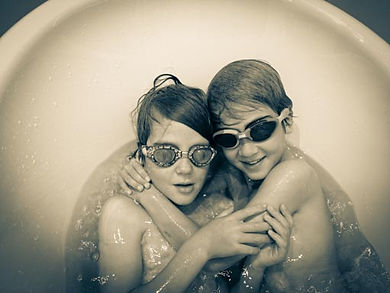 Photograph of boys in water