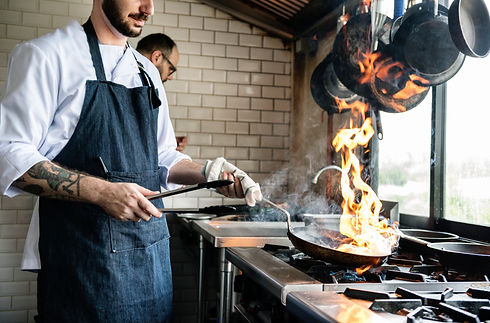 chef-cooking-food-in-the-restaurant-kitc
