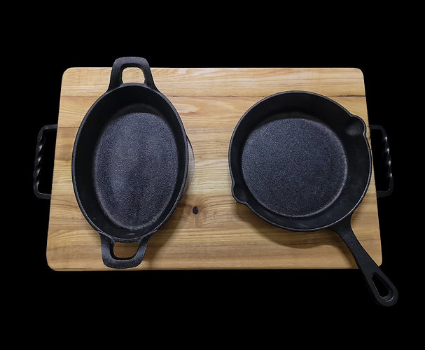 Handmade solid wood cutting boards and a set of two cast iron pans