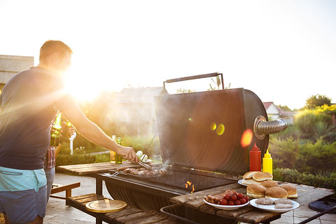 young-men-roasting-barbecue-grill-cottag