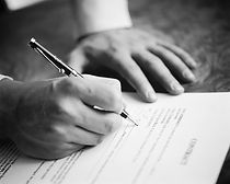 image of businessperson signing a contract