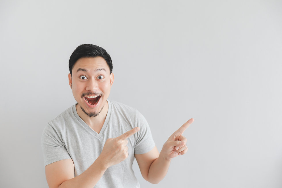 Wow and surprised face of Asian man in g