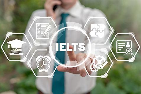 Man touches ielts acronym on virtual screen. IELTS International English Language Testing
