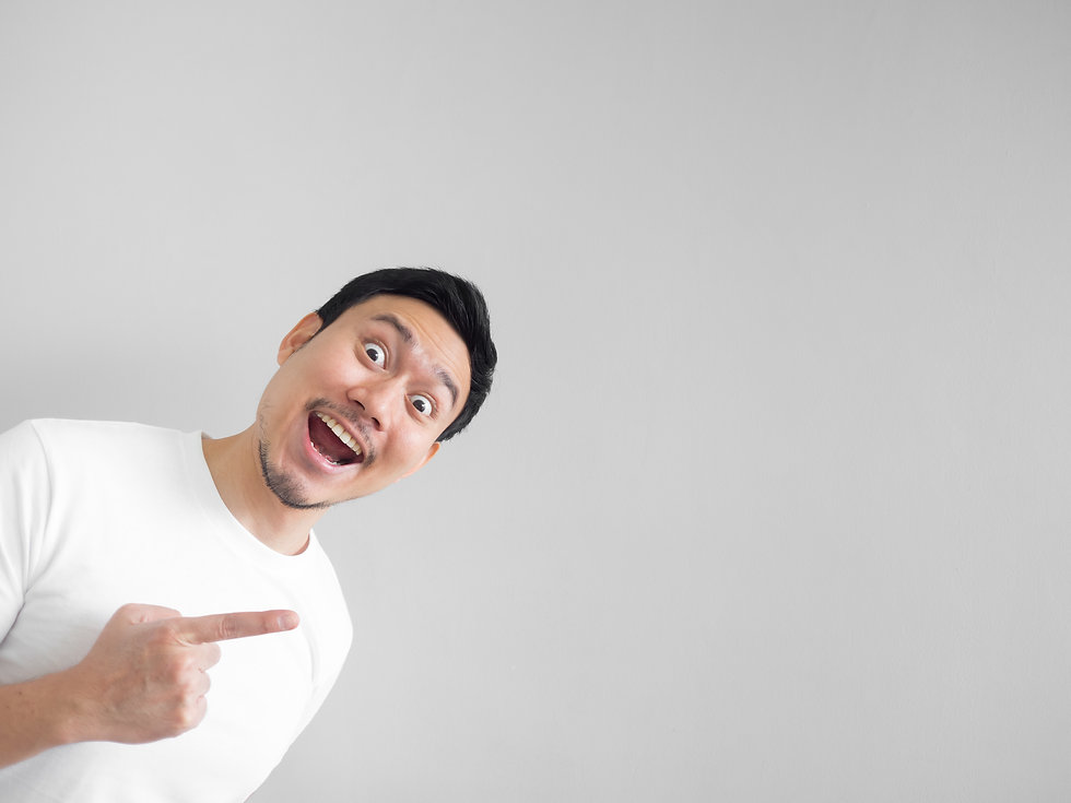 Surprised face of happy asian man in whi