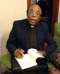 Fr. Armstrong sitting.JPG