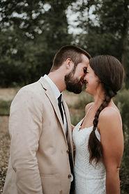 Lakeshore michigan beach wedding with tan suit and white dress, intimate wedding beach elopemet, small wedding in bridgman michigan