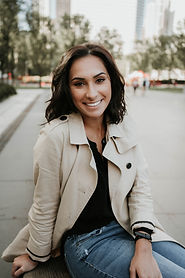Female headshot session and empowerment session downtown Chicago. Branding session tan jacket with jeans and black shirt