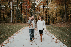 michigan fall family photo with toddler. cream sweater with black leggins and brown boots, husband, wife and toddle photoshoot ideas