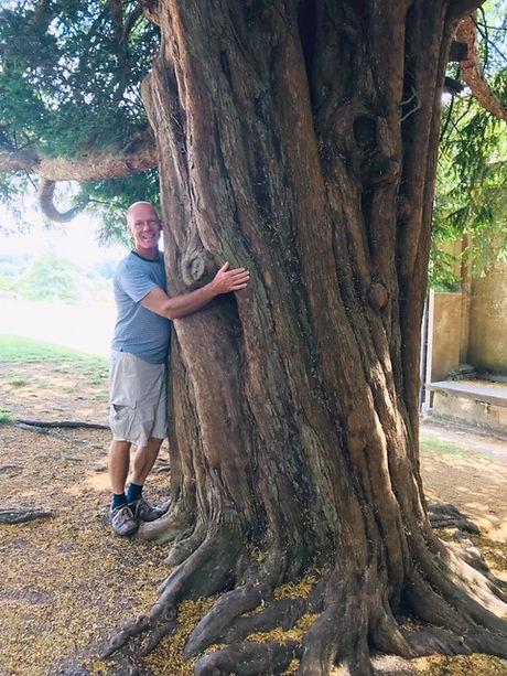 Mark hugging tree.JPG