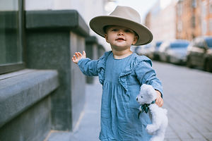 shallow-focus-photo-of-baby-wearing-hat-