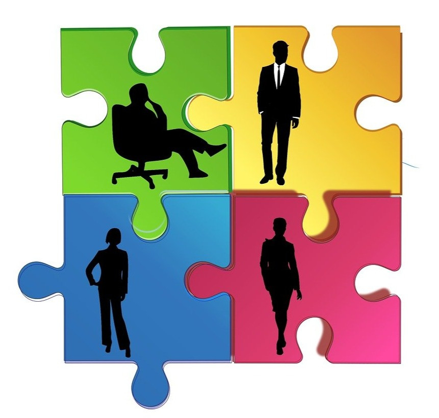 colorful interlocking puzzle pieces with depictions of shadowed individuals engaged in different poses and activities.