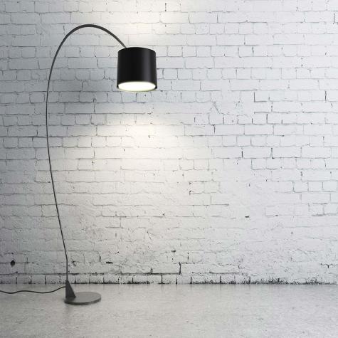 overhead lamp against brick wall