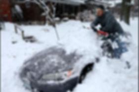 snow storm cleaning car.JPG
