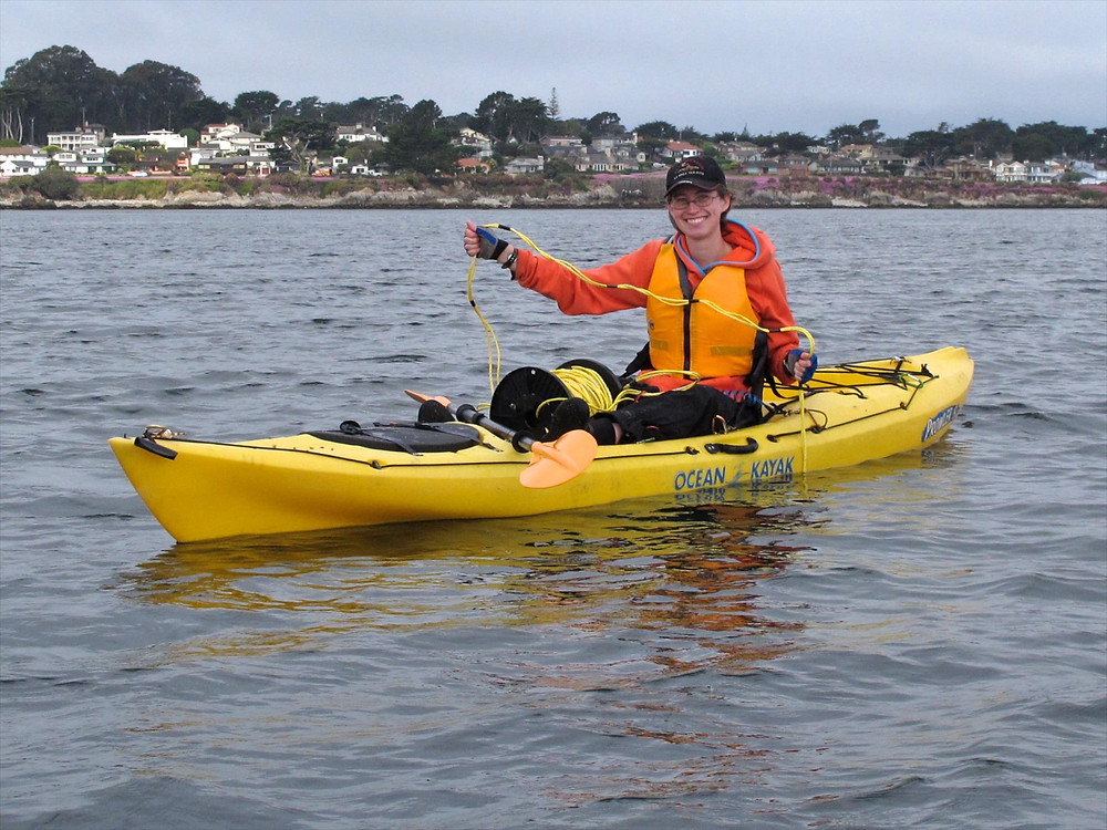 Teresa is collecting data for CSU, Monterey Bay's Squid Pod project using kayak-based camera systems
