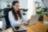 female-business-executive-using-laptop-k