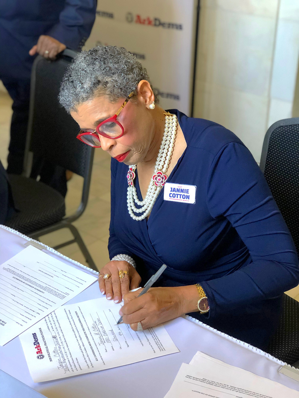 Jannie Cotton in action signing the paperwork to officially file to run for office.