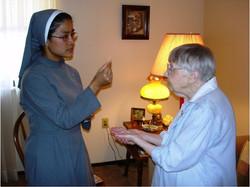 Sr. Eileen giving communion