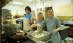 CMR sisters serving in the kitchen