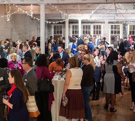 Guests mingling at a social event held at The Stockroom at 230