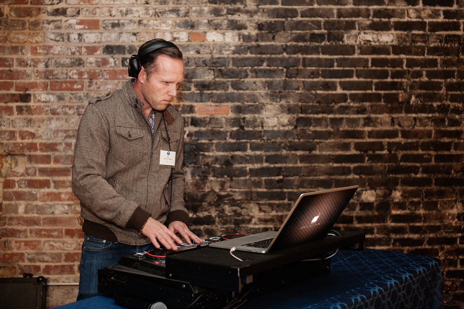dj at networking event at stockroom