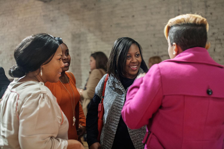 women talking at an event