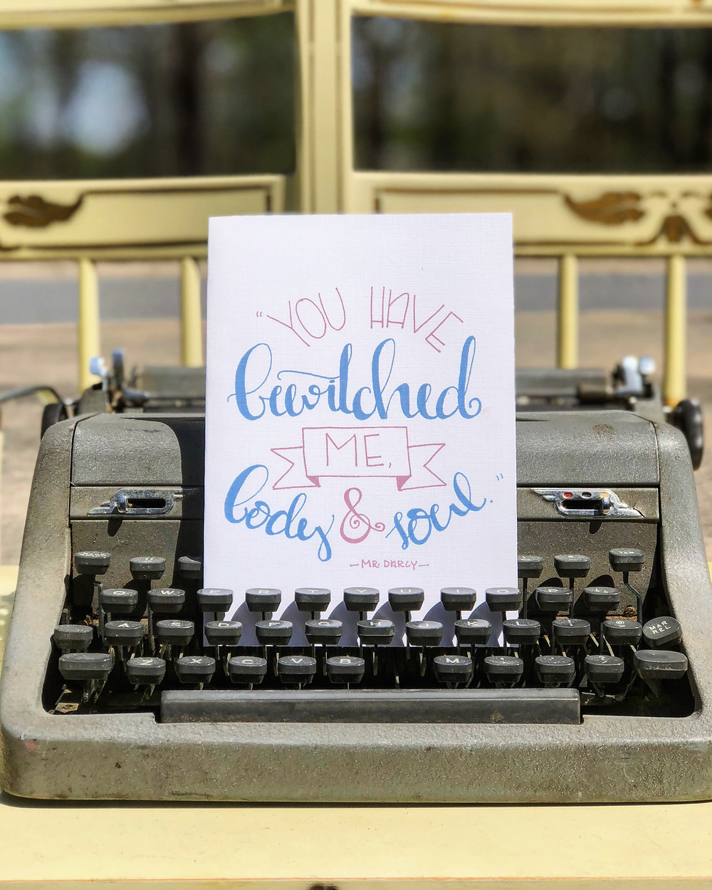 """This is a photo of a Jane Austen inspired card. The quote on the card is, """"You have bewitched me, body & soul,"""" words spoken by Mr. Darcy in Austen's novel."""