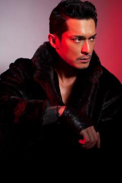 Miller Khan in SWANK Faur Fux Long Coat