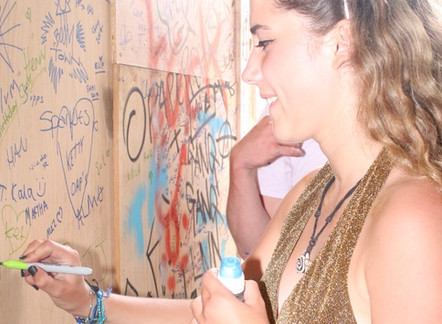 LOADS OF PEOPLE SIGN OUR WALL AT BOOMTOWN FESTIVAL