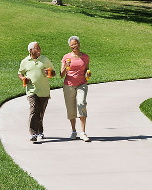Elderly Couple Power Walk