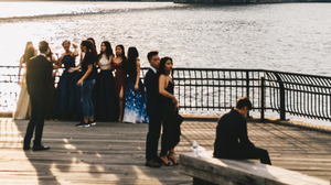Group of friends and their dates take prom pictures together