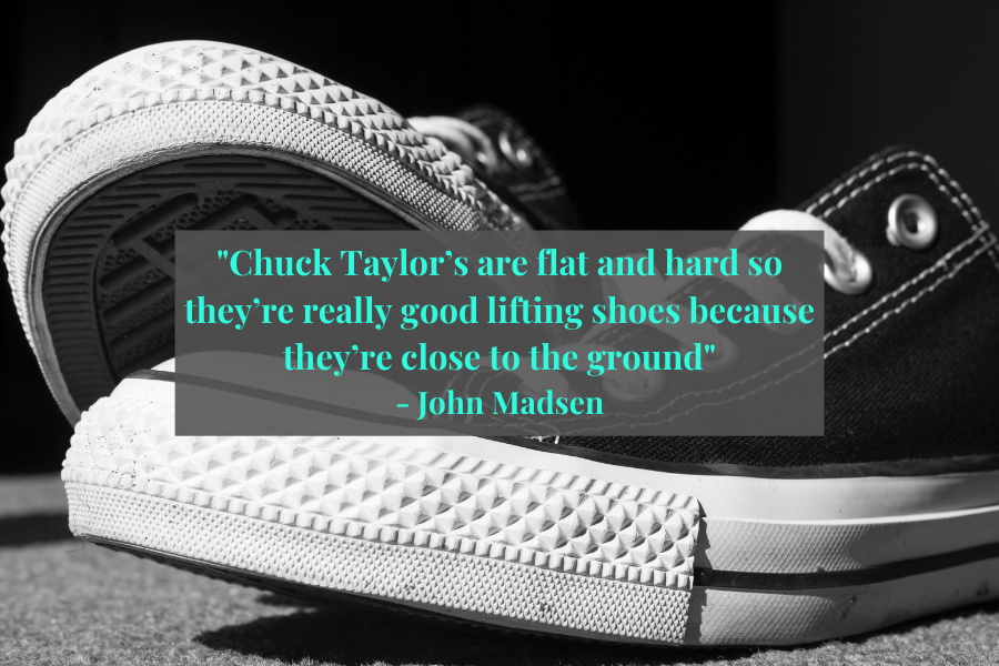 pair of converse chuck taylor with a quote from John Madsen